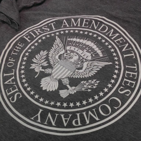 Seal of the First Amendment Tees Company